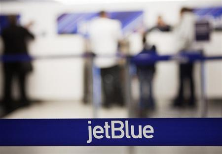 Customers check in at a JetBlue Airways counter at LaGuardia Airport in New York April 5, 2012. REUTERS/Lucas Jackson