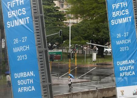 A woman walks past the International Convention Centre where the 5th BRICS Summit will be held, in Durban March 25, 2013. REUTERS/Rogan Ward