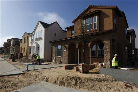 Construction workers put the finishing touches on newly built single family homes in San Diego, California March 25, 2013. REUTERS/Mike Blake