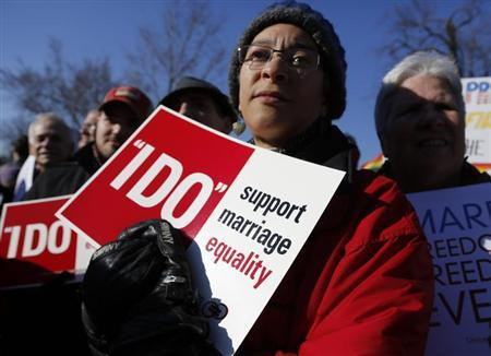 A pro-marriage demonstrator holds a sign outside of the U.S. Supreme Court in Washington, March 26, 2013. REUTERS/Jonathan Ernst