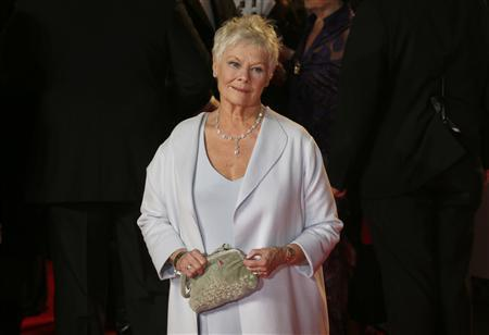 Actress Judi Dench arrives for the royal world premiere of the new 007 film ''Skyfall'' at the Royal Albert Hall in London in this October 23, 2012 file photo. REUTERS/Suzanne Plunkett/Files