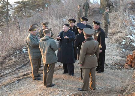 North Korean leader Kim Jong-Un (C) talks with generals as soldiers of the Korean People's Army (KPA) take part in the landing and anti-landing drills of KPA Large Combined Units 324 and 287 and KPA Navy Combined Unit 597, in the eastern sector of the front and the east coastal area on March 25, 2013 in this picture released by the North's KCNA news agency in Pyongyang March 26, 2013. REUTERS/KCNA (