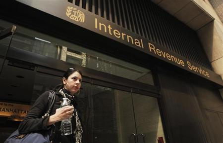 A woman walks out of an Internal Revenue Service office in New York April 18, 2011. REUTERS/Lucas Jackson
