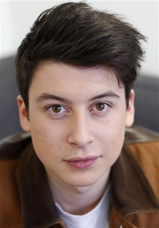 Nick D'Aloisio, aged 17, who developed the smartphone news app Summly, poses for a photograph at offices in central London March 26, 2013. REUTERS/Suzanne Plunkett