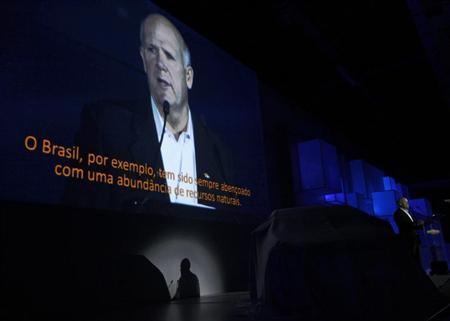 General Motors Chairman and Chief Executive Officer Dan Akerson addresses the Chevrolet Onix World Premiere in Sao Paulo October 21, 2012. REUTERS/Paulo Whitaker