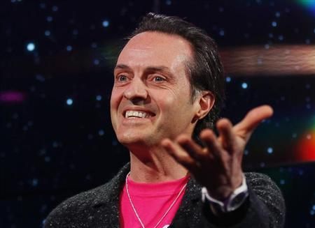 John Legere, Chief Executive Officer (CEO) of T-Mobile USA, gestures as he speaks to reporters at an announcement event at the Consumer Electronics Show (CES) in Las Vegas January 8, 2013. REUTERS/Rick Wilking