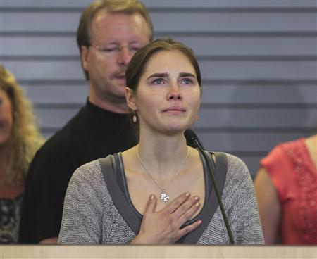 Amanda Knox pauses emotionally while speaking during a news conference at Sea-Tac International Airport, Washington after landing there on a flight from Italy, in this October 4, 2011, file photo. REUTERS/Anthony Bolante/Files