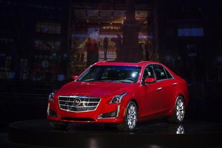 A 2014 Cadillac CTS sedan is displayed on stage during an unveiling ceremony in New York, March 26, 2013. REUTERS/Lucas Jackson