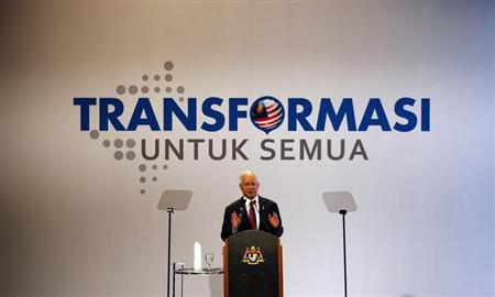 Malaysia's Prime Minister Najib Razak delivers his keynote address during the launch of the 2012 National Transformation Programme Annual Report during a live telecast at a TV station in Kuala Lumpur March 19, 2013. REUTERS/Bazuki Muhammad