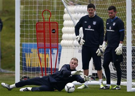 England's Joe Hart makes a save during a training session at the St George's Park training complex near Burton Upon Trent, central England, March 19, 2013. REUTERS/Darren Staples