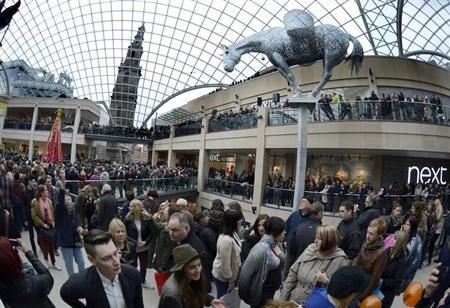 Shoppers walk in the newly opened Trinity Leeds shopping centre in Leeds, March 21, 2013. Work on the centre began in 2008 but was delayed due to the recession. REUTERS/Nigel Roddis