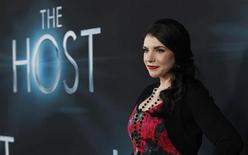 "Author and producer Stephenie Meyer poses at the premiere of ""The Host"" in Hollywood, California March 19, 2013. The movie opens in the U.S. on March 29. REUTERS/Mario Anzuoni"