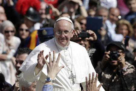 Pope Francis waves as he leaves after the Palm Sunday mass at Saint Peter's Square at the Vatican March 24, 2013. REUTERS/Max Rossi
