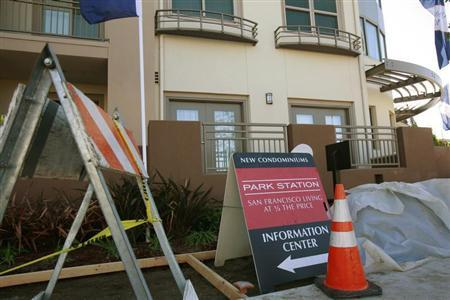 Construction equipment sits next to signs advertising new condominium homes for sale in South San Francisco, California, December 22, 2009. REUTERS/Robert Galbraith