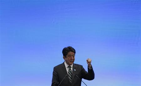Japan's Prime Minister Shinzo Abe gestures as he delivers his speech during the ruling Liberal Democratic Party (LDP) annual convention in Tokyo March 17, 2013. REUTERS/Toru Hanai