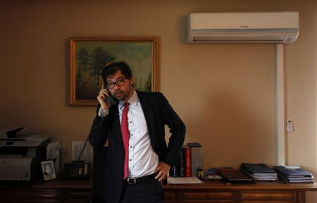 Afghanistan's Deputy Foreign Minister Jawed Ludin talks on the phone before an interview in Kabul March 27, 2013. REUTERS/Mohammad Ismail