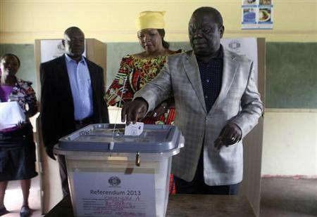 Zimbabwe's Prime Minister and President of the Movement for Democratic Change (MDC) Morgan Tsvangirai (R) and his wife Elizabeth cast his vote in a referendum at a polling station in Harare March 16, 2013. REUTERS/Philimon Bulawayo