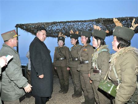 North Korean leader Kim Jong-Un (2nd L) talks with soldiers of the Korean People's Army (KPA) taking part in the landing and anti-landing drills of KPA Large Combined Units 324 and 287 and KPA Navy Combined Unit 597, in the eastern sector of the front and the east coastal area on March 25, 2013, in this picture released by the North's KCNA news agency in Pyongyang March 26, 2013. REUTERS/KCNA (NORTH KOREA - Tags: POLITICS MILITARY)