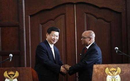 South Africa's President Jacob Zuma (R) shakes hands with China's President Xi Jinping after a media briefing at the presidential guest house in Pretoria March 26, 2013. REUTERS/Siphiwe Sibeko