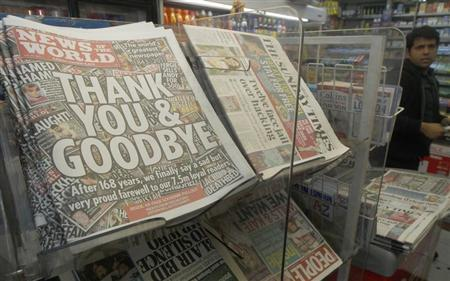 Copies of the final edition of the News of the World, alongside other Sunday papers, are displayed for sale in a newsagent in London July 10, 2011. REUTERS/Luke MacGregor