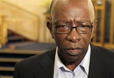 Suspended FIFA executive member Jack Warner talks to journalists at the lobby of a hotel in Zurich in this file photo taken May 30, 2011. REUTERS/Arnd Wiegmann/Files