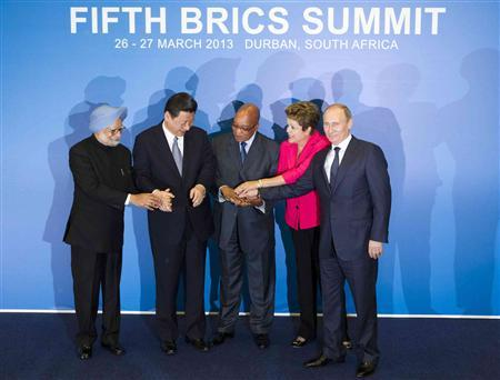 (L-R) Indian Prime Minister Manmohan Singh, Chinese President Xi Jinping, South African President Jacob Zuma, Brazilian President Dilma Rousseff and Russian President Vladimir Putin pose for a family photograph during the fifth BRICS Summit in Durban, March 27, 2013. REUTERS/Rogan Ward