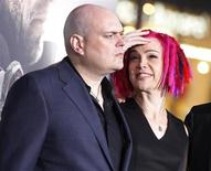 "Andy Wachowski (L) and sibling Lana Wachowski, the screenwriters, producers and directors of the new film ""Cloud Atlas,"" pose as they arrive for the film's premiere at Grauman's Chinese theatre in Hollywood, California, October 24, 2012. REUTERS/Fred Prouser"