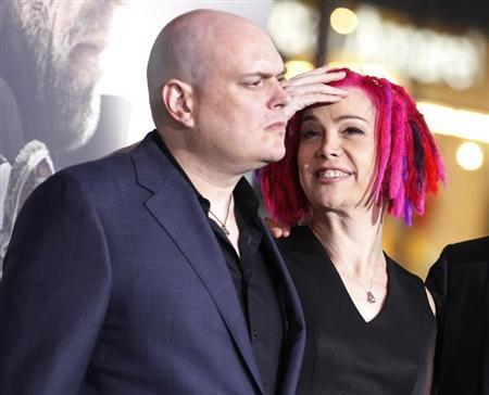 Andy Wachowski (L) and sibling Lana Wachowski, the screenwriters, producers and directors of the new film ''Cloud Atlas,'' pose as they arrive for the film's premiere at Grauman's Chinese theatre in Hollywood, California, October 24, 2012. REUTERS/Fred Prouser
