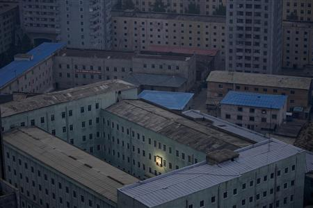 A picture of North Korea's founder Kim Il-sung decorates a building in Pyongyang early October 5, 2011 in this file photo. REUTERS/Damir Sagolj/Files