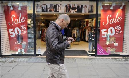 A man walks past a shop on Oxford Street, in central London May 27, 2011. REUTERS/Paul Hackett
