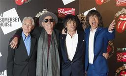 "The Rolling Stones (L-R) Charlie Watts, Keith Richards, Ronnie Wood and Mick Jagger pose as they arrive for the opening of the exhibition ""Rolling Stones: 50"" at Somerset House in London, in this July 12, 2012 file picture. REUTERS/Ki Price/File"