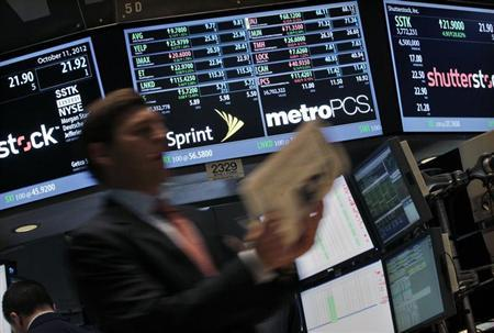 Traders work on the floor of the New York Stock Exchange near the post that trades Sprint and MetroPCS, October 11, 2012. REUTERS/Brendan McDermid