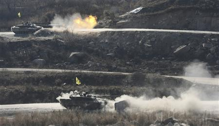 South Korean soldiers from an armored unit participate in a field firing in Pocheon, 46 km (28 miles) northeast of Seoul and about 15 km (9 miles) south of the demilitarized zone separating the two Koreas, March 27, 2013. REUTERS/Lim Byong-sik/Yonhap
