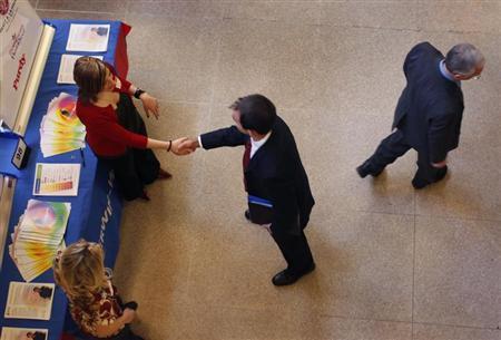 Job seekers attend a career fair at Rutgers University in New Brunswick, New Jersey, January 6, 2011. REUTERS/Mike Segar