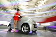 Le constructeur automobile chinois Dongfeng Motor Group ne va pas maintenir son offre de rachat d'une participation dans la société américaine en difficulté Fisker Automotive, spécialiste des voitures électriques, estimant qu'il serait trop difficile de transférer la production en Chine, selon trois sources proches du dossier. /Photo d'archives/REUTERS/Aly Song