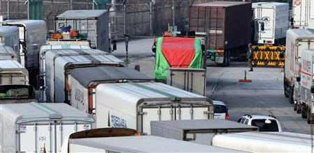 A South Korean soldier (top R) stands to check vehicles heading to the inter-Korean industrial park in the North Korean border city of Kaesong, at the CIQ (Customs, Immigration and Quarantine) office, south of the demilitarised zone separating the two Koreas, in Paju, north of Seoul March 28, 2013. REUTERS/Lim Byeong-sik/Yonhap