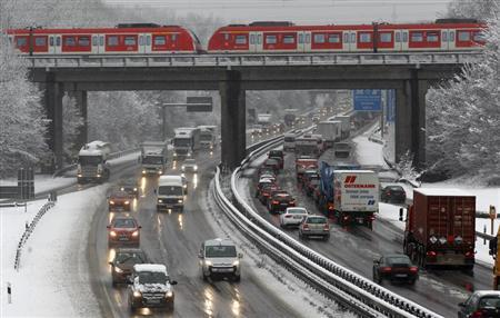 A heavy traffic is pictured on a snow covered motorway in Bochum February 6, 2013. REUTERS/Ina Fassbender