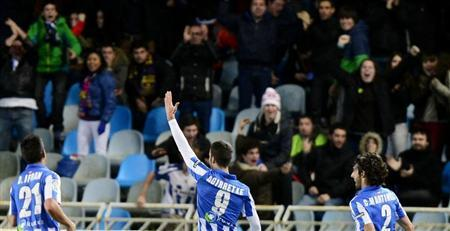 Real Sociedad's (L-R) Diego Ifran, Imanol Agirretxe and Carlos Martinez celebrate a goal against Barcelona during their Spanish first division soccer match at Anoeta stadium in San Sebastian January 19, 2013. REUTERS/Vincent West