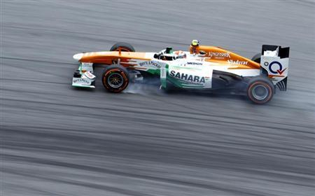 Force India Formula One driver Adrian Sutil of Germany drives during the second practice session of the Malaysian F1 Grand Prix at Sepang International Circuit outside Kuala Lumpur, March 22, 2013. REUTERS/Samsul Said