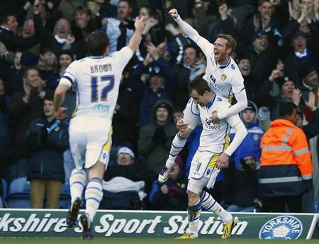 Leeds United's Luke Varney (C) celebrates his goal against Tottenham Hotspur with team mate Paul Green (R) during their FA Cup fourth round match at Elland Road in Leeds, northern England, January 27, 2013. REUTERS/Darren Staples