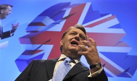 Britain's former Minister of State for Further Education, Skills and Lifelong Learning John Hayes delivers his speech on the second day of the Conservative Party Conference in Manchester, northern England October 3, 2011. REUTERS/Toby Melville