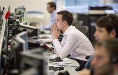 A trader looks at his screen on the IG Group trading floor in London March 18, 2013. REUTERS/Neil Hall