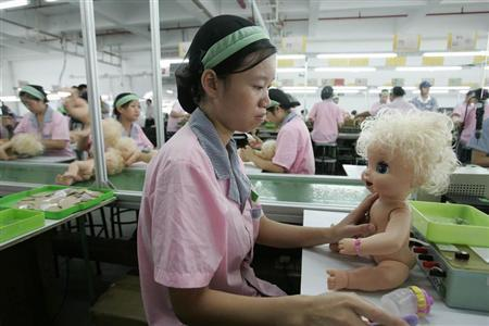 Labourers work at a production line at a toy factory in Panyu, south China's Guangdong province, September 4, 2007. REUTERS/Aly Song