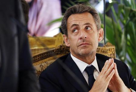 Former French President Nicolas Sarkozy listens to the speech of Belgian Foreign Minister Didier Reynders (unseen) after awarding him with the French Legion d'Honneur during a ceremony at the Egmont Palace in Brussels March 27, 2013. REUTERS/Francois Lenoir