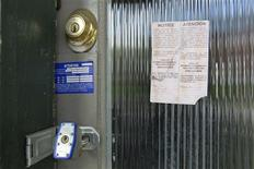A padlock and foreclosure papers are attached to the front door of a home in the Price Hill neighborhood of Cincinnati, Ohio March 24, 2012. REUTERS/John Sommers II/Files