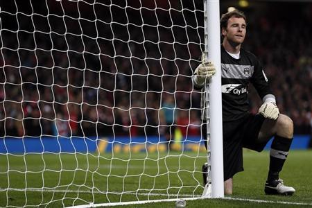 Coventry City's goalkeeper Joe Murphy reacts after Arsenal's Ignasi Miquel scored during their English League Cup match at the Emirates Stadium in London September 26, 2012. REUTERS/Stefan Wermuth