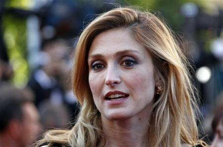 French actress Julie Gayet arrives on the red carpet for the screening of the film ''Moonrise Kingdom'', by director Wes Anderson, in competition at the 65th Cannes Film Festival May 16, 2012. REUTERS/Jean-Paul Pelissier