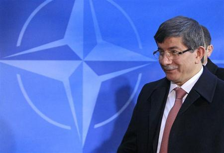 Turkish Foreign Minister Ahmet Davutoglu arrives at a two-day NATO foreign ministers at the Alliance's headquarters in Brussels December 4, 2012. REUTERS/Yves Herman