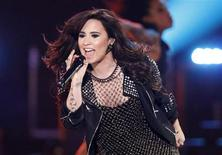 "Recording artist Demi Lovato performs ""Give Your Heart a Break"" during the VH1 Divas 2012 show in Los Angeles, December 16, 2012. REUTERS/Danny Moloshok"
