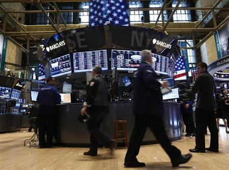 Traders work on the floor at the New York Stock Exchange, March 15, 2013. REUTERS/Brendan McDermid